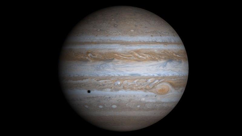 Снимок аппарата Кассини (слева - тень от спутника Европа)