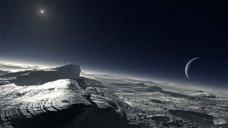 Так может выглядеть поверхность Плутона. Вдалеке виден Харон