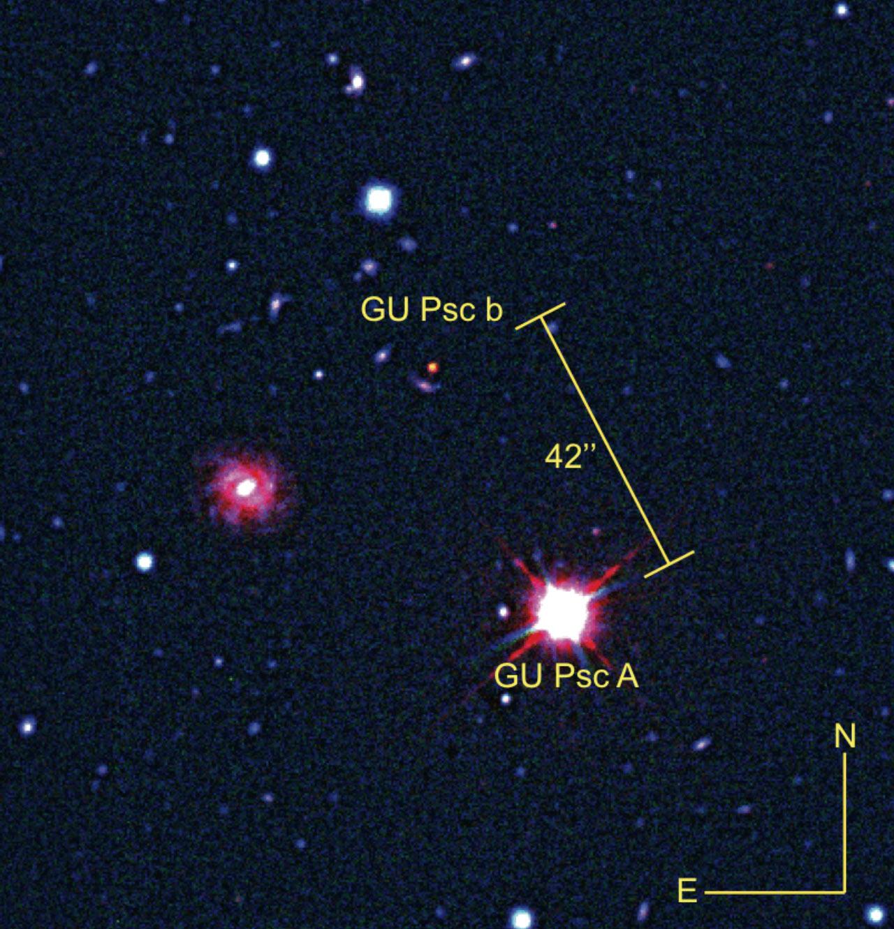 Это составное изображение показывает экзопланету GU Psc b и материнскую звезду