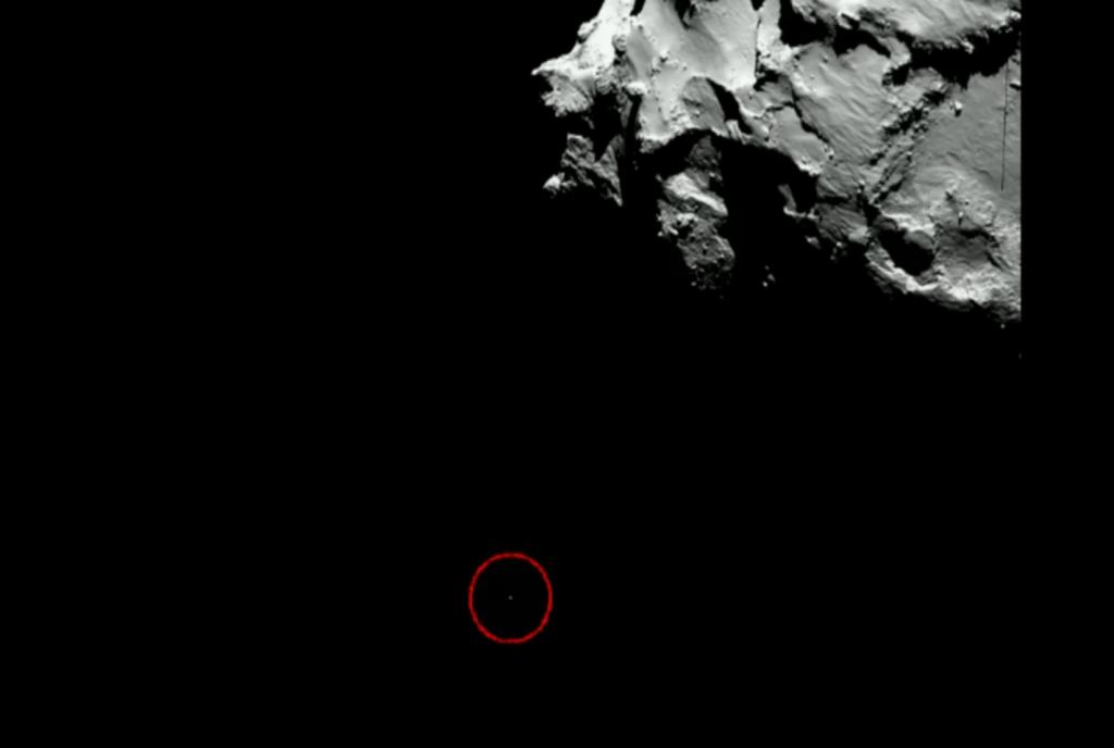 Посадочный модуль Philae на фоне кометы